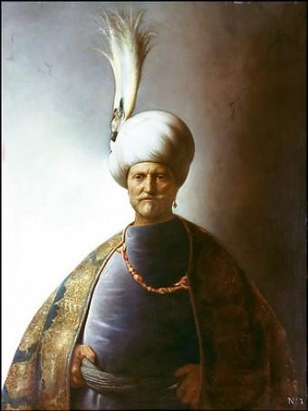 Мужчина в восточном костюме султан